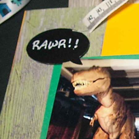 """Talk Bubble Labels fit Various Household Jars and Containers image of dinosaur and talk bubble sticker with the word """"RAWR!!"""" written on it, placed on some colorful paper."""