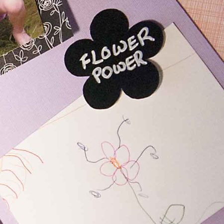 """Flower Labels fit Various Household Jars and Containers with flower label with """"Flower Power"""" written on it, near child's drawing of flower on scrapbook paper"""