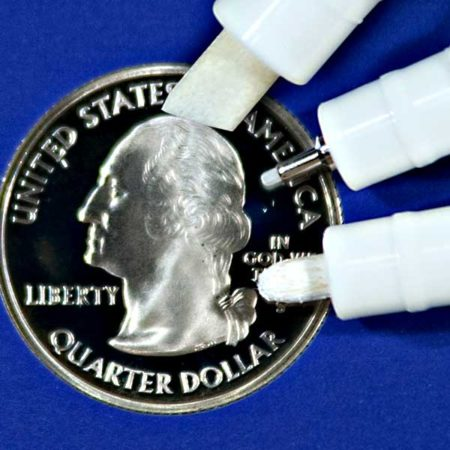 Showing the tip sizes of 6mm, 1/2mm and 2mm Paint Markers with a US Quarter for size comparison