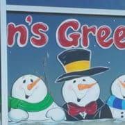 Zig Posterman marker used on a window three snowmen with Seasons Greetings in a 3d font