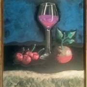 Ricardo Godoy loves creating liquid chalk art paintings with Zig Posterman chalk markers from Cohas and has created a still life of a wine glass, cherries, and an apple on a chalkboard.