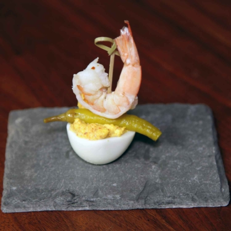 Set of Mini 4 by 6 Inch Slate Appetizer and Tapas Food Platters, shows image of mini platter with deviled egg, pepper, and shrimp stuck with skewer through the top. Image courtesy of Duncan Seibert.