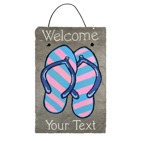 """Personalized Summer Flip Flop Sandals Welcome Slate Sign features a pair of pink and blue striped flip flop style sandals with the words """"Welcome"""" and """"Your Text"""" in white font."""